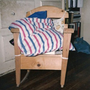 Pillow in a wooden rocking-chair