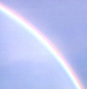 Rainbow in a blue sky