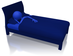 person sleeping in bed in darkened room with shadows under the bed